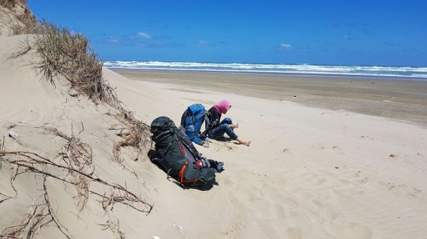 Barefoot walking on 90 Mile Beach NZ